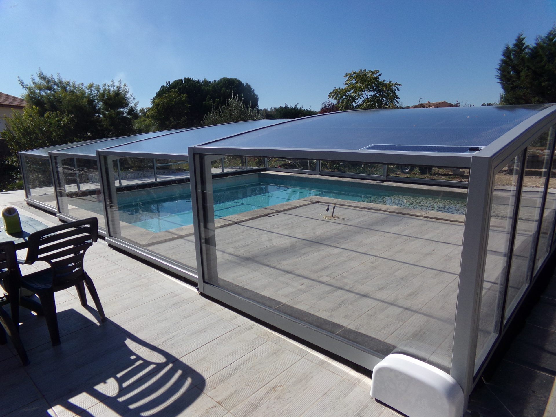 Abri de piscine haut mod le ath nes bel abri for Abri de piscine sans rail au sol