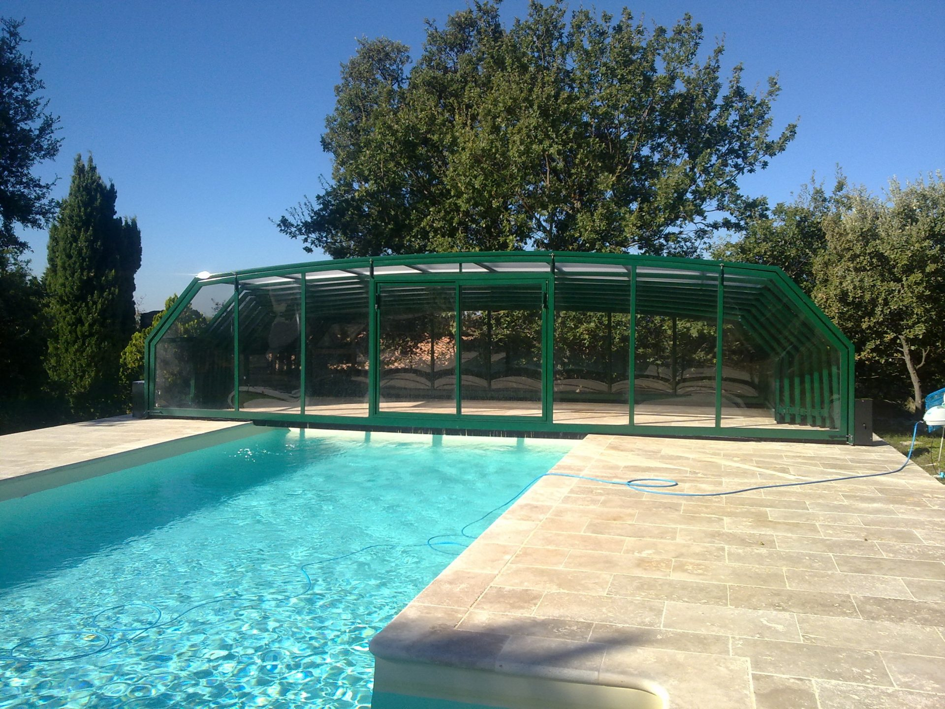 Abri piscine sur mesure les mod les bel abri for Abri de piscine sans rail au sol