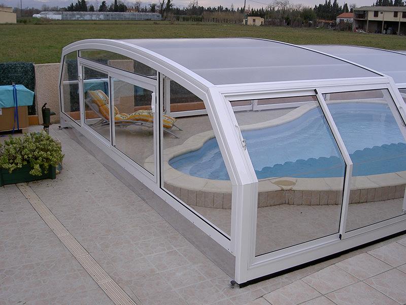 Abri piscine paris t lescopique sur roulette for Abris piscine occasion